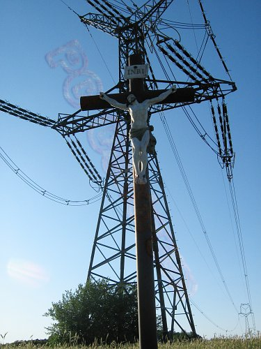 Crucifix and power pole